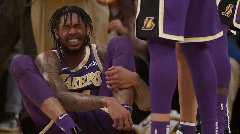LOS ANGELES, CALIF. - DEC. 5, 2018. Lakers forward Brandon Ingram winces in pain after being fouled