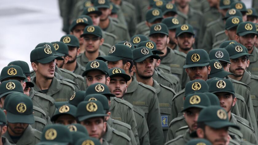 Iranian Revolutionary Guard members arrive for a ceremony celebrating the 40th anniversary of the Islamic Revolution, at the Azadi, or Freedom, Square, in Tehran on Feb. 11.