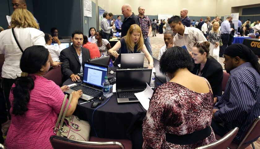FILE - In this Sept. 10, 2014 file photo, job seekers create resumes at the NJ Department of Labor's resume clinic in the Atlantic City Convention Center in Atlantic City, N.J. Ten U.S. states still have not regained all the jobs they lost in the Great Recession, even after six and a half years of recovery, while many more have seen only modest gains. New Jersey has nearly 1 percent fewer jobs than it did at the end of 2007, and Missouri is just below its pre-recession level. (Michael Ein/The Press of Atlantic City via AP) MANDATORY CREDIT