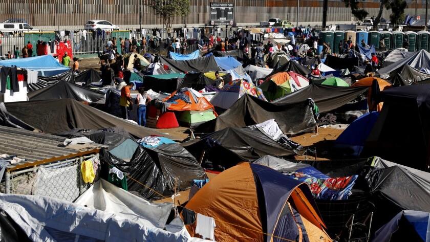 TIJUANA, BAJA CALIF. -- MONDAY, NOVEMBER 26, 2018: Members of the migrant caravan take shelter at th