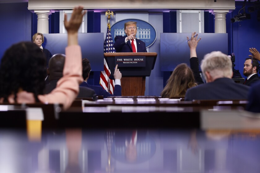 President Trump calls on reporters during a news conference on Saturday at the White House.