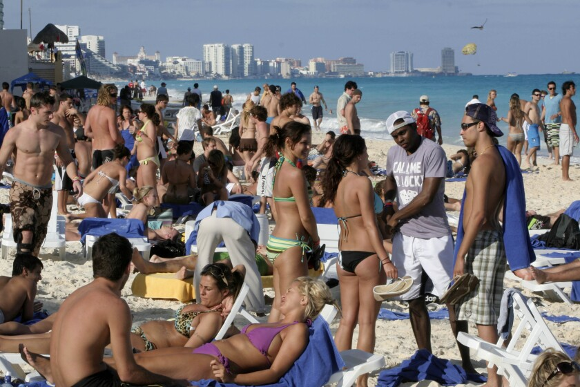 Spring-breakers at the beach in the resort city of Cancun, Mexico, in 2009.