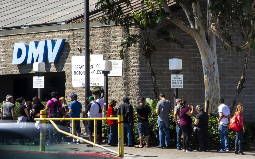 California is opening 25 DMV field offices on Friday but with social distancing rules to avoid the kind of lines seen at the South Los Angeles office in 2018.