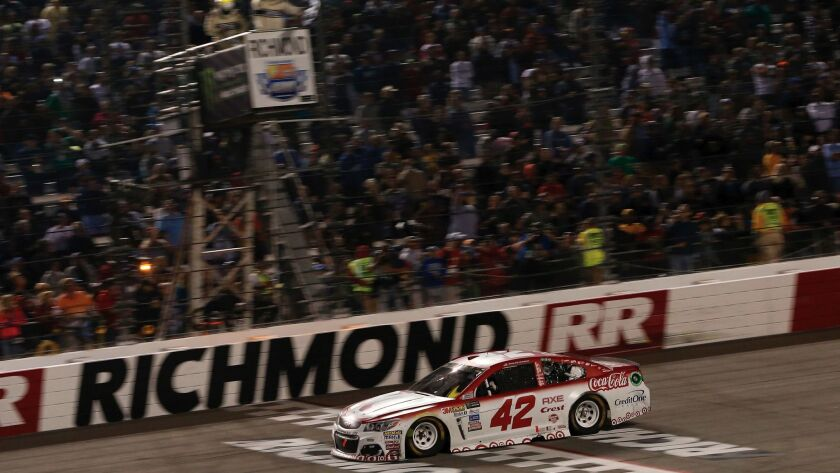 Kyle Larson crosses the finish line to win the NASCAR Cup Series race at Richmond Raceway on Sept. 9.