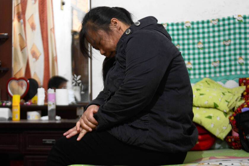 Two young cousins caught in a rivalry between two kindergartens in China's Hebei province were poisoned in April. Above, the mother of Ren Xinyi, 6, one of the victims.