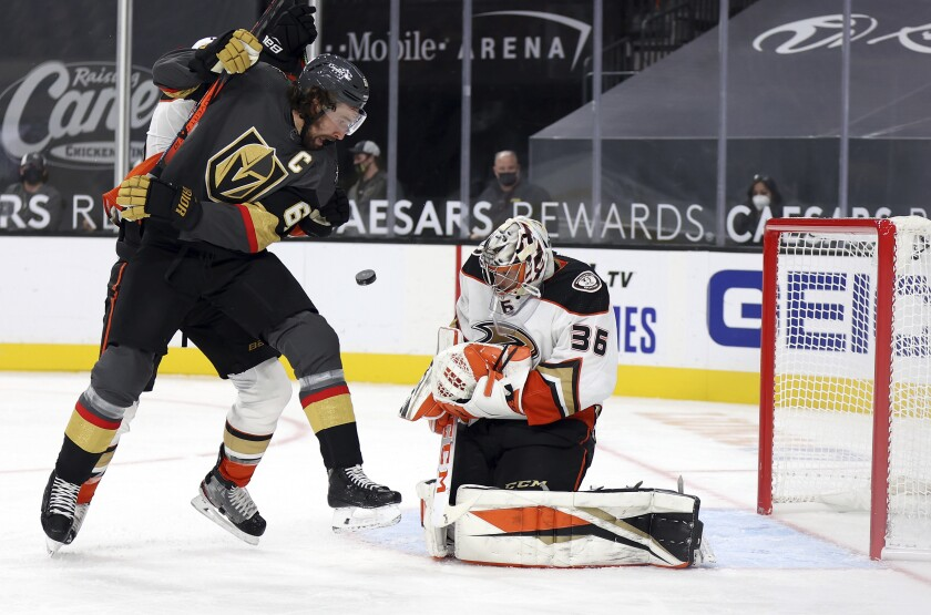 Anaheim Ducks goalie John Gibson (36) blocks a shot as Vegas Golden Knights right wing Mark Stone (61) looks for the rebound during the second period of an NHL hockey game Tuesday, Jan. 14, 2020, in Las Vegas. (AP Photo/Isaac Brekken)