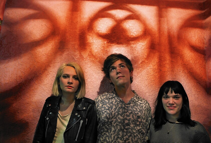Cherry Glazerr members Clementine Creevey, left, Sean Redman and Hannah Uribe.