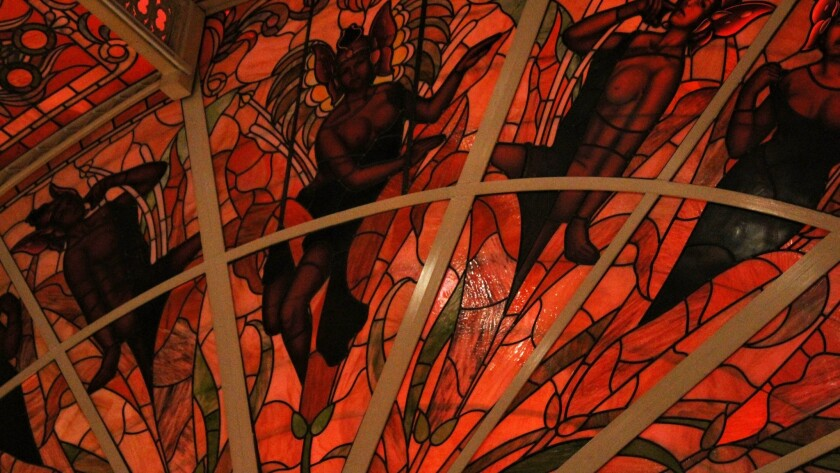 With stained glass in shades of red, black and gold, the ceiling above the Tropicana's casino covers