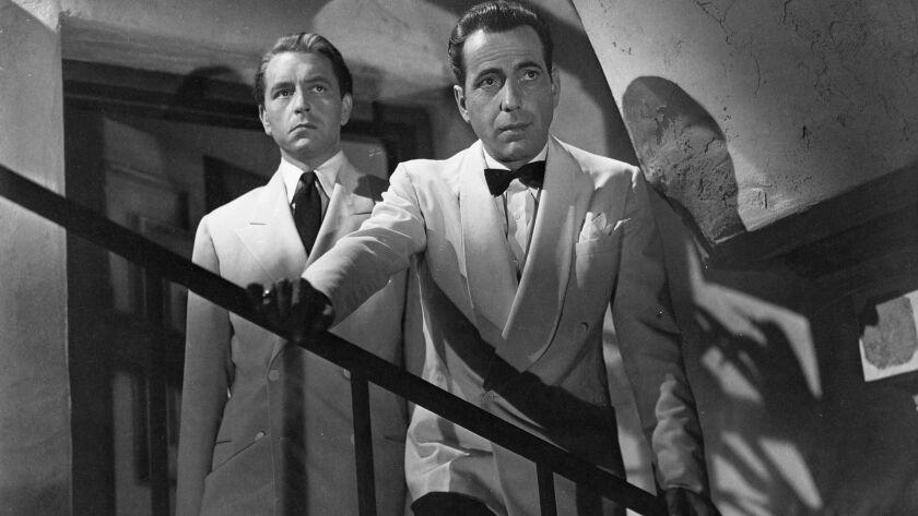 "(L-R) - Paul Henreid as Victor Laszlo and Humphrey Bogart as Rick Blaine in ""CASABLANCA,"" (1942) dir"