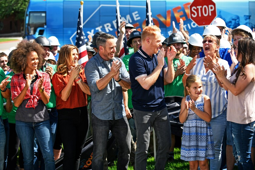 """The home reveals for disadvantaged homeowners are especially moving on HGTV's """"Extreme Makeover: Home Edition."""" The show's three designers line up behind host Jesse Tyler Ferguson, center."""