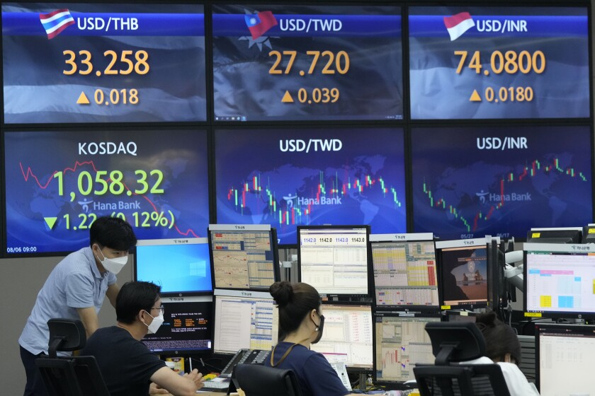 Currency traders watch monitors at the foreign exchange dealing room of the KEB Hana Bank headquarters in Seoul, South Korea, Friday, Aug. 6, 2021. Asian stock markets sank Friday after Wall Street rose to a high as investors waited for U.S. jobs data for an update on how coronavirus flareups are affecting the biggest global economy. (AP Photo/Ahn Young-joon)
