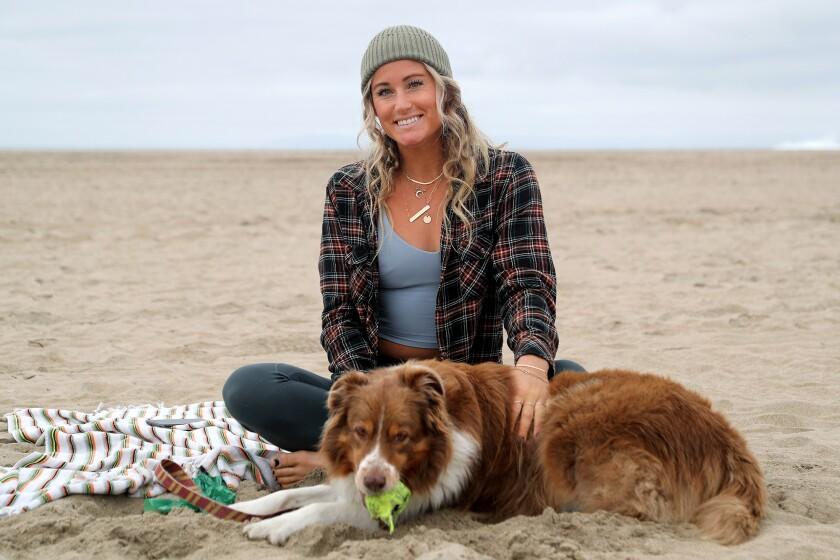 Newport Beach yoga instructor Chelsey Lowe, 30, and her Australian shepherd Gryffin.