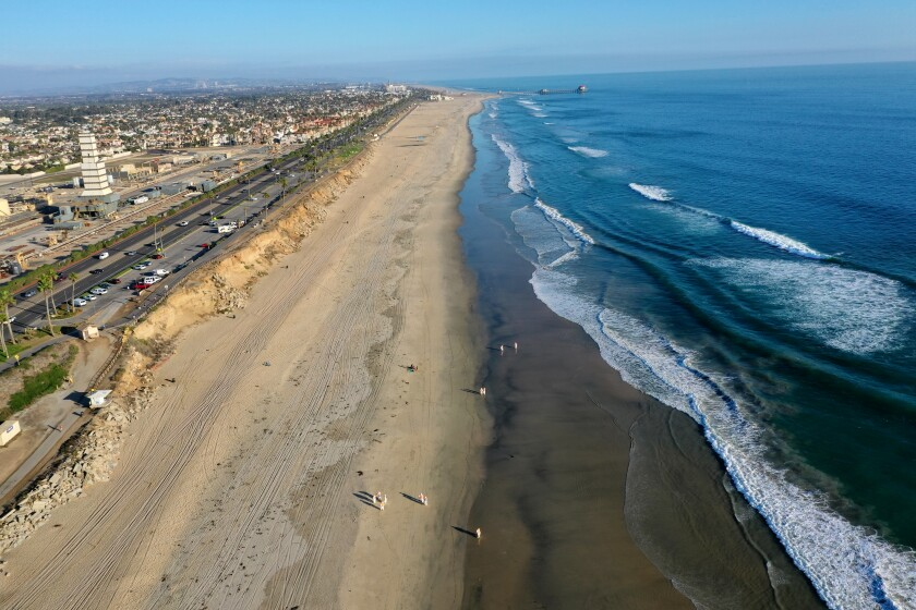 An aerial view of cleanup crews working in Huntington Beach on Oct. 5 after an oil spill off the coast.