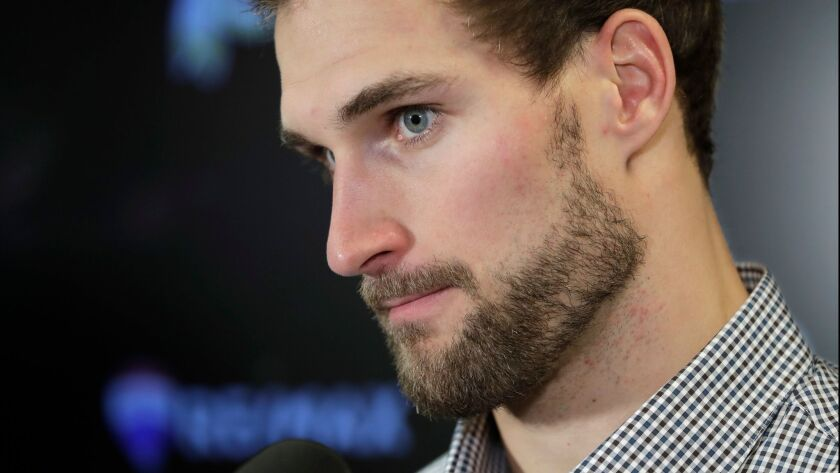 Washington Redskins quarterback Kirk Cousins listens to a question during a news conference after an