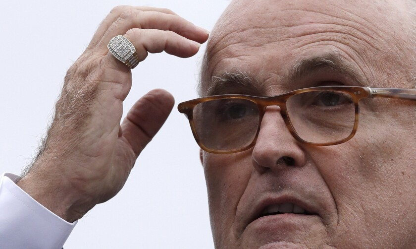 Rudy Giuliani attends a campaign event for Eddie Edwards, who is running for the U.S. Congress in New Hampshire, on Aug. 1.