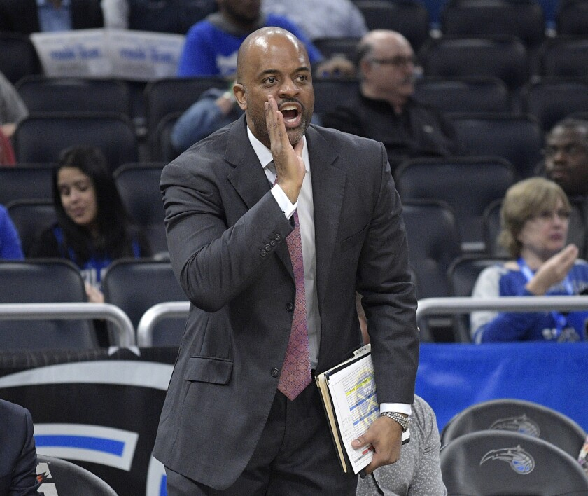 FILE - In this Dec. 5, 2018, file photo, Denver Nuggets assistant coach Wes Unseld Jr. calls out instructions during the second half of an NBA basketball game against the Orlando Magic, in Orlando, Fla. The Wizards are set to formally introduce Wes Unseld Jr. as their new coach Monday, July 19, 2021, after hiring him to replace Scott Brooks. (AP Photo/Phelan M. Ebenhack, File)