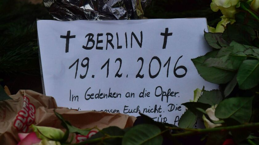 "A card reading ""In memory of the victims"" is seen Dec. 20 at the site where a truck crashed into a Christmas market in Berlin."