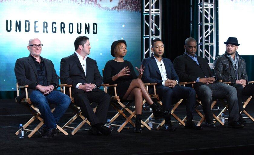 "Akiva Goldsman, from left, Joe Pokaski, Misha Green, John Legend, Mike Jackson and Anthony Hemingway discuss ""Underground"" at the TCA winter tour on Friday."