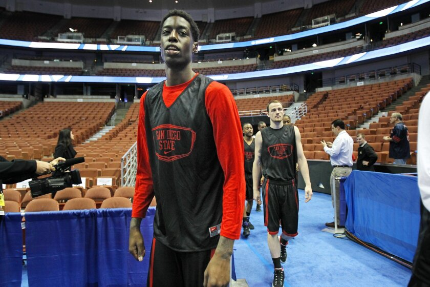 SDSU's Dwayne Polee walks out to practice for their Sweet 16 game against Arizona.