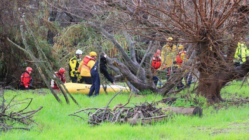 Rescue workers recovered the body of a man swept away in his vehicle in Rainbow California. A search continues for a child reported missing.