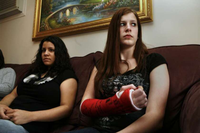 In 2008, Alicia Sgro, right, then 14, and Jennifer Jones were at a Long Island Wal-Mart where an employee was killed in a crowd stampede. Sgro was injured beforehand. An angry woman in the crowd attacked her, she said, fracturing her arm and injuring her nose.