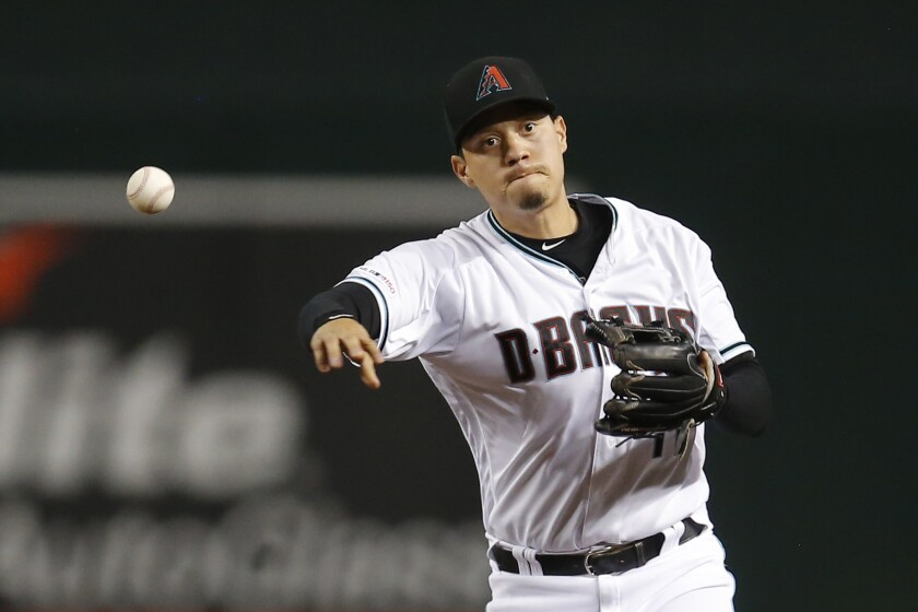 FILE - In this Tuesday, Aug. 20, 2019 file photo, Arizona Diamondbacks second baseman Wilmer Flores (41) in the first inning during a baseball game against the Colorado Rockies, in Phoenix. Versatile infielder Wilmer Flores and the San Francisco Giants finalized a $6.25 million, two-year contract Wednesday, Feb. 12, 2020 as spring training began, giving the club a proven hitter against left-handed pitching. (AP Photo/Rick Scuteri, File)