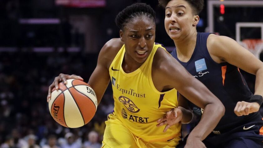 Los Angeles Sparks forward Nneka Ogwumike, left, dribbles past Connecticut Sun guard Layshia Clarend