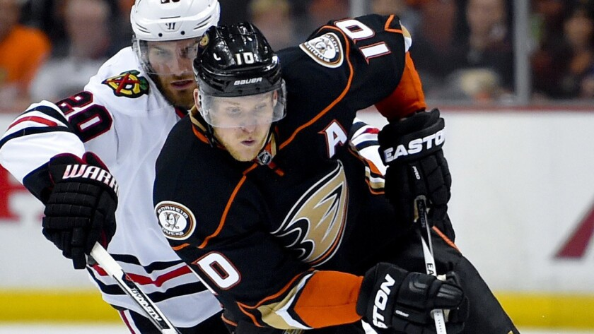 Ducks forward Corey Perry controls the puck in front of Chicago Blackhawks forward Brandon Saad during Game 2 of the Western Conference finals at Honda Center on May 19.
