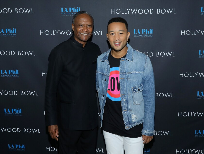 Conductor Thomas Wilkins, left, and John Legend.