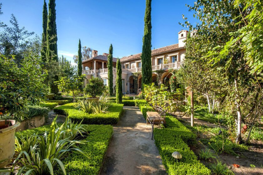 The more than three-quarters of an acre of grounds include formal gardens.
