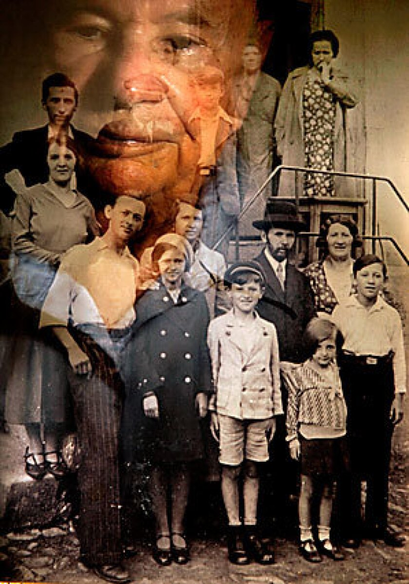 Sol Berger, 88, a Holocaust survivor, is reflected in a family photo, taken when he was a child, living in Krosno, Poland. Berger is third from right in the top row. Berger is visiting Krosno for the first time since World War II.