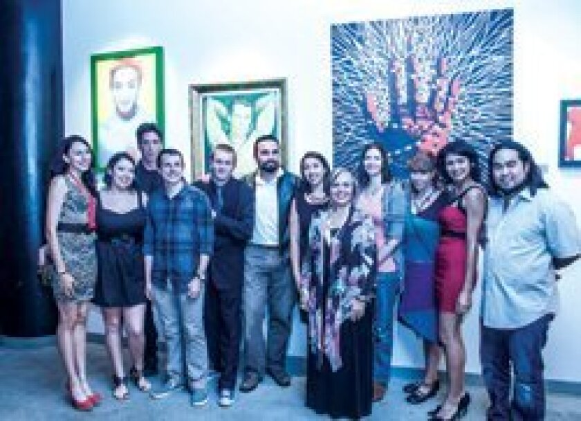 StageHANDS artists and friends gather in front of several large-scale prints by set designer Syd Stevens, back row, third from left.