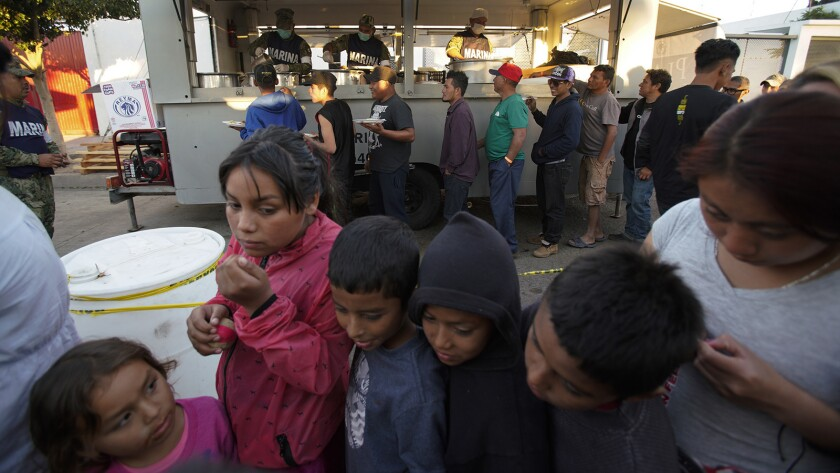 The day after the border clash between migrants and U.S. Border Patrol, life continued as children w