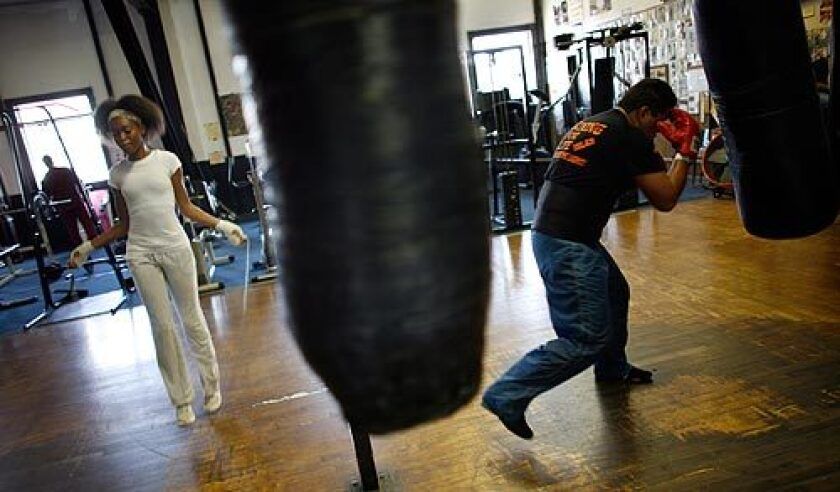 Broadway Gym in Watts has been turning out boxers for more than 30 years. It has seen its ups and downs in the tough neighborhood of South L.A., but like a solid fighter, it has always managed to go the distance. Winter Wyatt, 16, left, skips rope as Alfredo Islas works the heavy bag in the gym. Islas used to box in Mexico and just started hitting the gym after a seven-year absence. More photos >>>