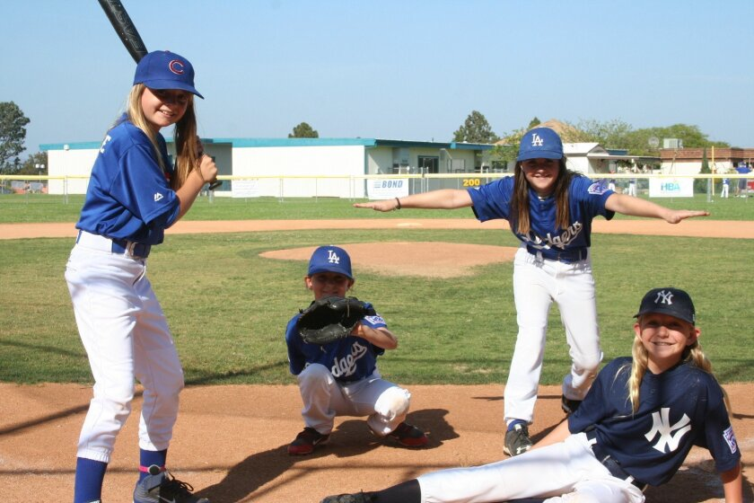 Four girls are playing this year in the Solana Beach Little League's AAA Division: Brielle Carre, Emma Levy, Peyton Johnson and Revere Schmidt.