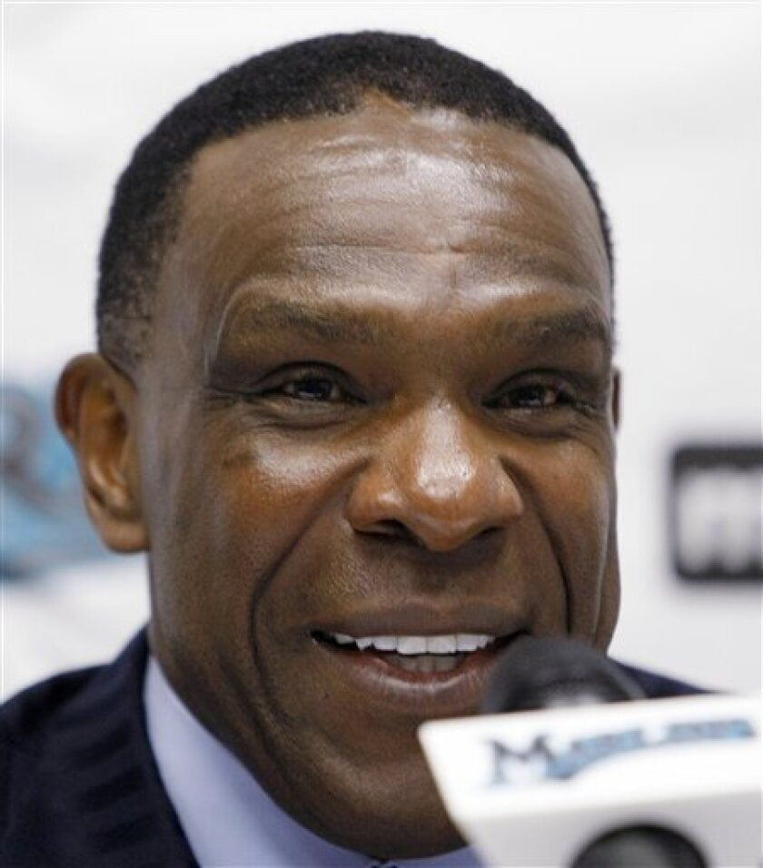 "Former baseball player Andre Dawson smiles as he talks to reporters during a news conference at Landshark Stadium in Miami, Wednesday, Jan. 6, 2010. Dawson has been elected to the Hall of Fame while Bert Blyleven and Roberto Alomar fell just short of earning baseball's highest honor. Dawson hit 438 homers with 1,591 RBIs in a career that spanned from 1976-96. Nicknamed ""The Hawk,"" he was voted NL Rookie of the Year in 1977 with Montreal and NL Most Valuable Player in 1987 with the Chicago Cubs, the first member of a last-place team to earn the honor. (AP Photo/Alan Diaz)"