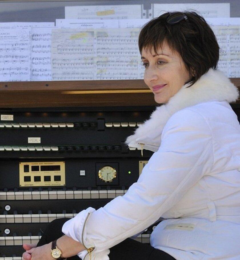 Spreckels organist Carol Williams listens to the Children's Choir. Photo: Bob Lang