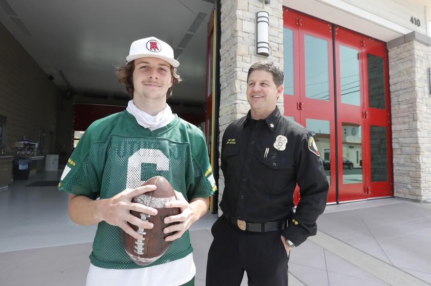 Edison senior quarterback Braeden Boyles, stands with his dad, Newport Beach Fire Chief Jeff Boyles.
