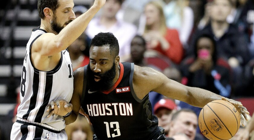 Houston Rockets guard James Harden (13) dribbles as San Antonio Spurs guard Marco Belinelli (18) def