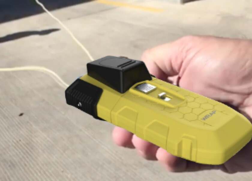 The BolaWrap devices are about the size of a larger cellphone and shoot Kevlar cords around a person's legs or arms. The LAPD will start testing the devices in January.