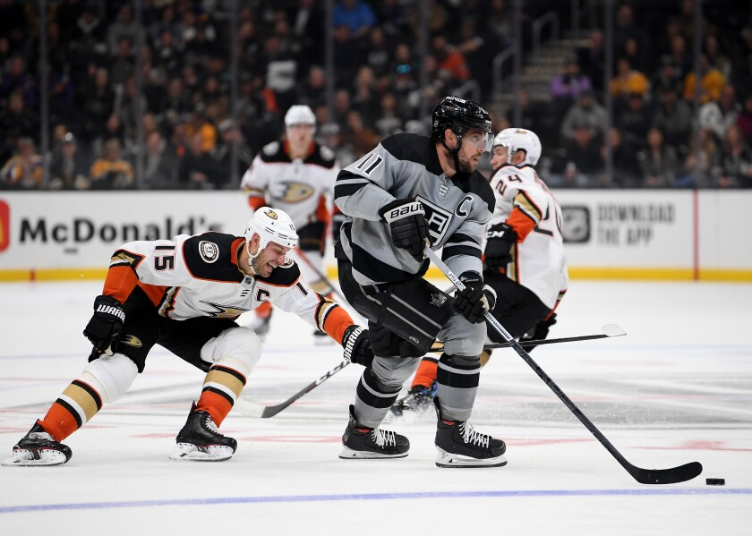 Kings center Anze Kopitar brings the puck up ice during a game against the Ducks on Feb. 1, 2020, at Staples Center.