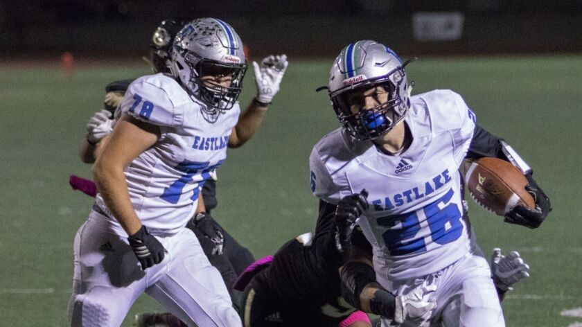 Eastlake senior Adrian Hinojosa slips a tackle and nearly reaches the end zone against Olympian on Friday night.