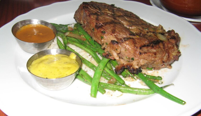 A 12-ounce rib-eye supper at Green Dragon Tavern & Museum in Carlsbad. CREDIT: Pam Kragen