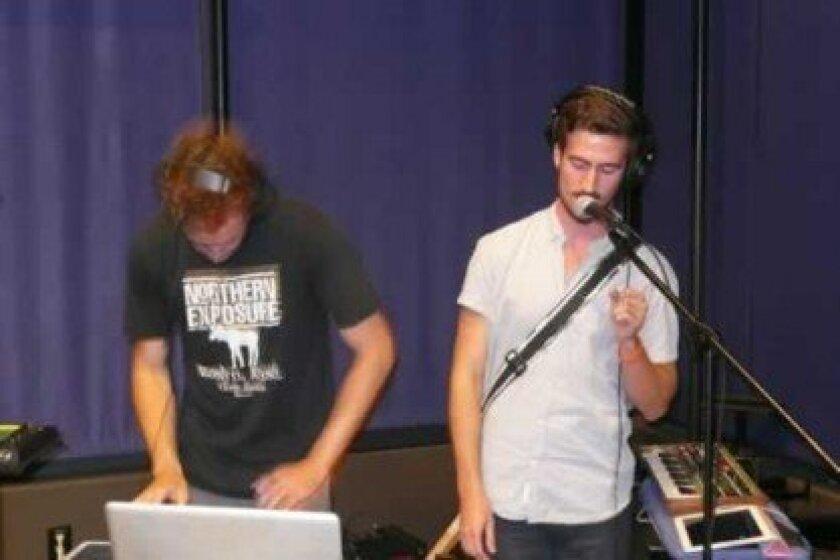 David Lopez de Arenosa (right) and band member play computer-enhanced DJ music.
