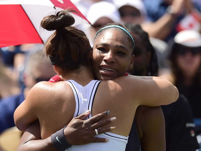 Serena Williams fights back tears as she embraces Rogers Cup winner Bianca Andreescu on Sunday in Toronto.
