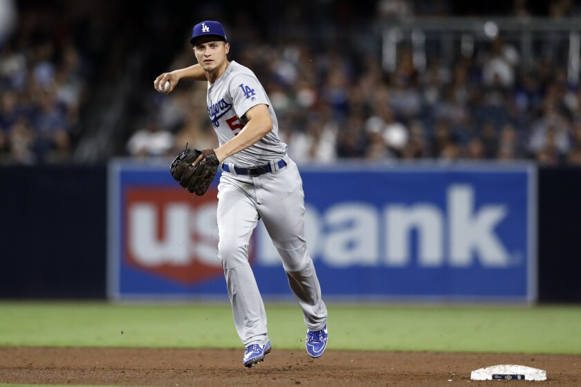 Dodgers shortstop Corey Seager makes a throw to first base.