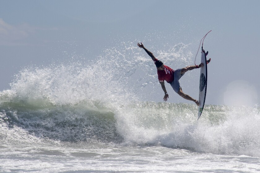 Brazil's Gabriel Medina rides a wave during the first round of the Olympic men's surfing competition.