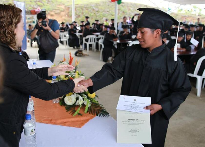 Photo taken on Dec. 14, 2018 in Caldono, Colombia, showing people graduating from an agricultural training program designed to help reintegrate former FARC guerrillas into society. EFE-EPA/Ernesto Guzman Jr.