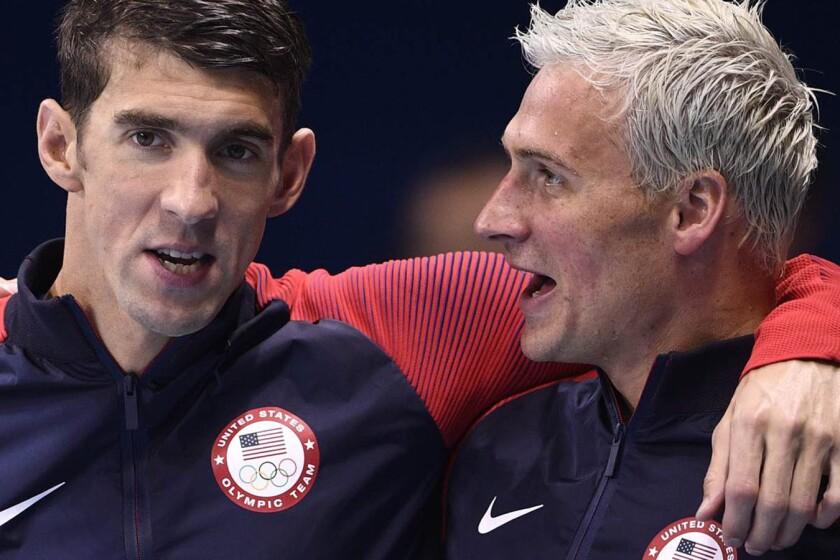 Michael Phelps (i) y Ryan Lochte, en una competencia.
