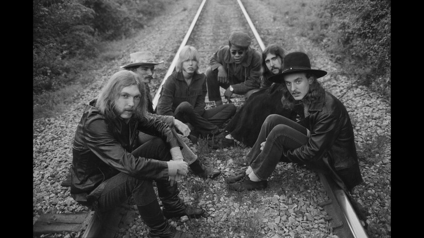 The Allman Brothers (L-R) Duane Allman, Dickey Betts, Gregg Allman, Jai Johanny Johanson, Berry Oakley and Butch Trucks sit on some rairoad tracks on May 5, 1969 outside of Macon, Georgia.